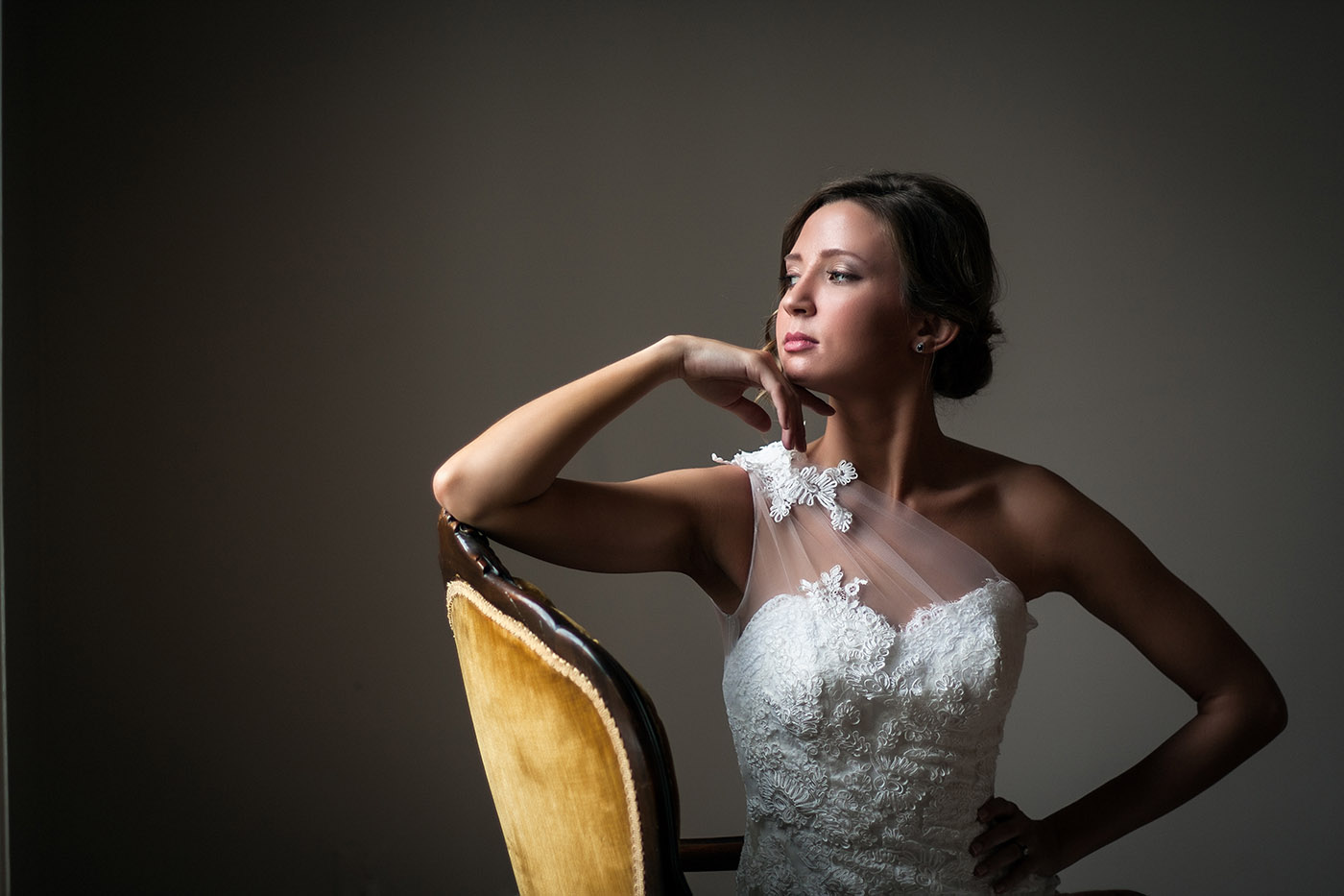 Fashion Photography: Woman in dress sitting in a chair